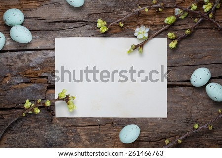 rustic easter background with spring twigs and bird's eggs on a wooden background - stock photo