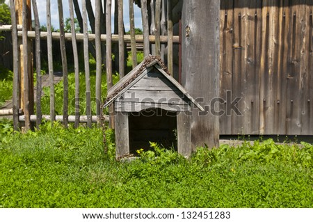 Rustic fence and dog houses - stock photo