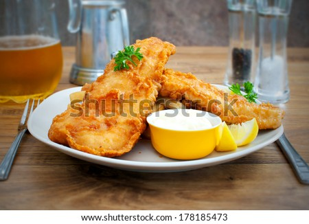 Rustic fish and chips  - stock photo