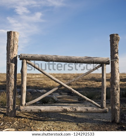 rustic gate made of logs - stock photo