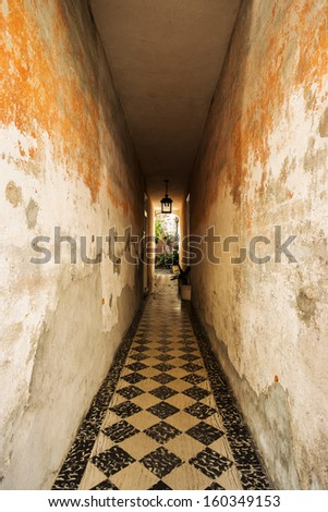 Rustic hallway in the French Quarter in Charleston, South Carolina. - stock photo