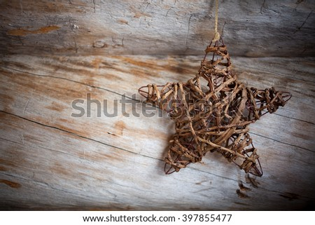 Rustic heart hanging against weathered wood - stock photo