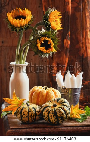 Rustic interior still life with sunflowers and gourds - stock photo
