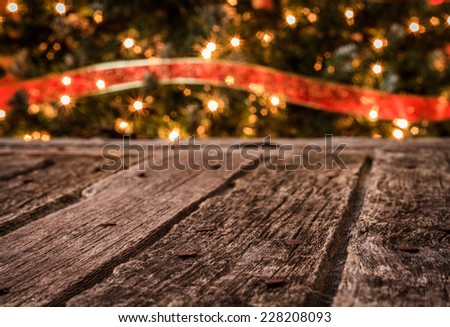Rustic Old Barn Wood with Christmas Tree& Red Ribbon Background - stock photo
