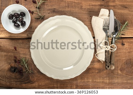 Rustic Old Wooden Mediterranean Restaurant Table With Cutlery - stock photo