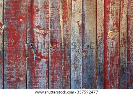 Rustic old wooden wall with faded red paint. - stock photo