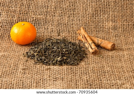 Rustic picture of ingredients for spiced fruity tea - stock photo