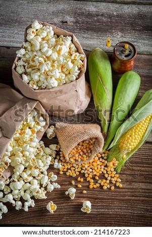 Rustic popcorn and raw corn - stock photo