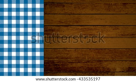 Rustic retro background with old brown wooden planks and blue white tablecloth - stock photo
