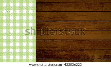 Rustic retro background with old brown wooden planks and green white tablecloth - stock photo