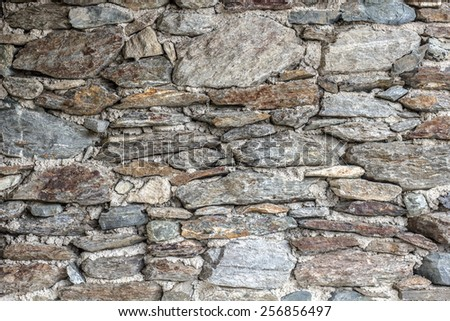 Rustic stone wall - stock photo