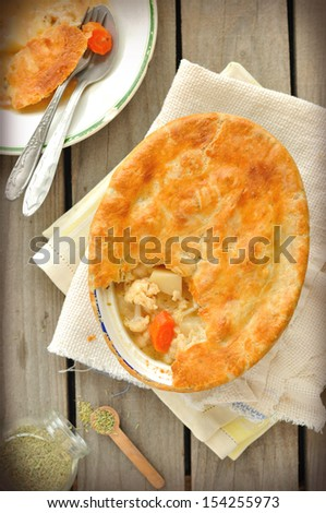 Rustic style chicken and vegetable pot pie - stock photo