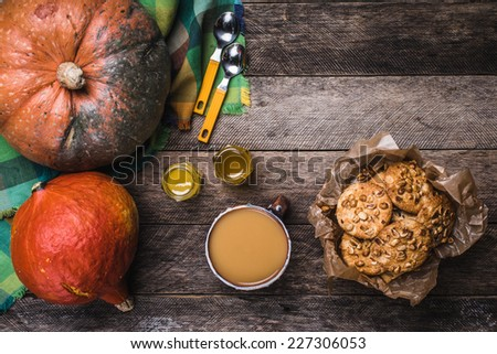 Rustic style pumpkins, soup, honey and cookies with nuts on wood. Autumn Season food photo - stock photo