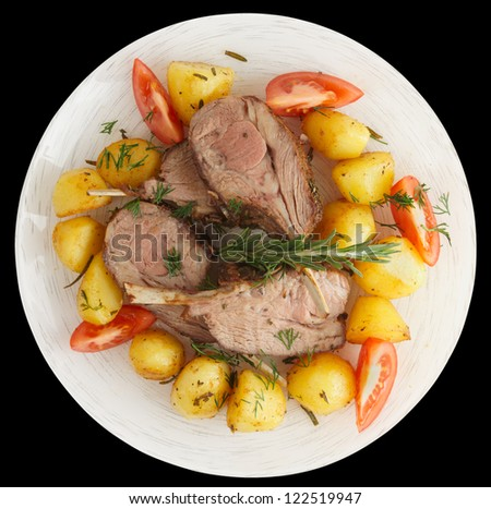 Rustic style rack of lamb with fried potatoes isolated on black - stock photo