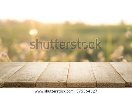 Rustic table against the morning rising sun for product display montage. - stock photo