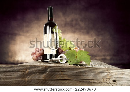 rustic table of wine  - stock photo