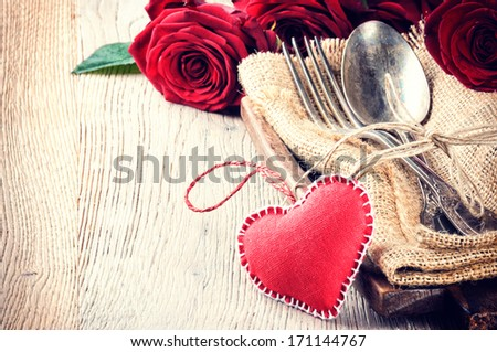 Rustic table setting for St Valentine's dinner  - stock photo
