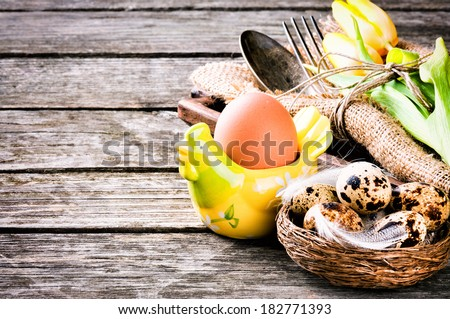 Rustic table setting with quail eggs for Easter holiday  - stock photo