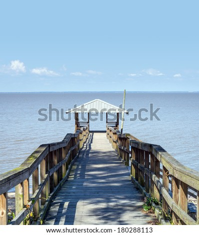 Rustic vintage wooden fishing and swimming pier off the beaten path - stock photo