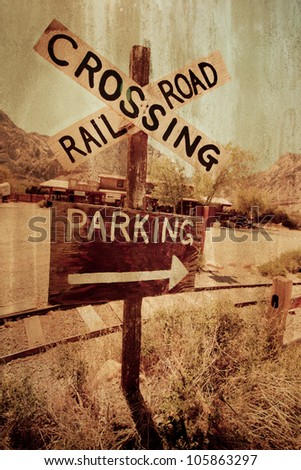 Rustic western railroad crossing with grungy texture effect - stock photo