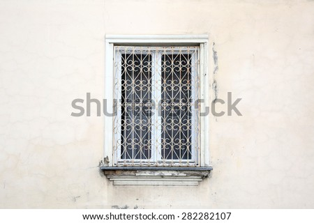 rustic window in white rural house - stock photo