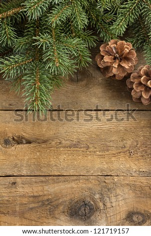 Rustic wood background with pine cones and needles - stock photo