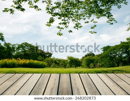 rustic wood floor in front of the big tree - stock photo