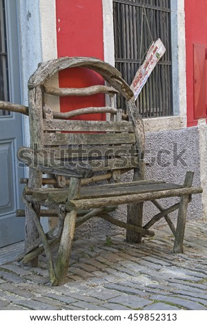Rustic wooden bench in an alley of the town of Motovun - stock photo