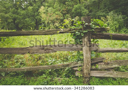 Rustic wooden fence with vintage filter effect - stock photo