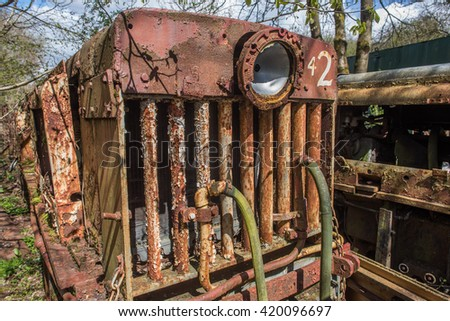 Rusting abandoned mine train outside clearwell caves, Monmouthsire - stock photo