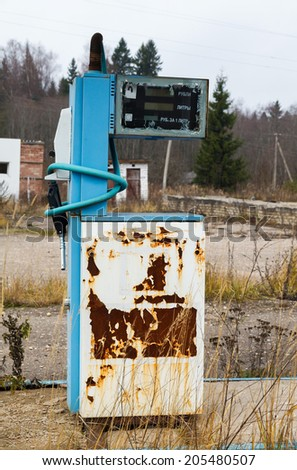 rusty abandoned pump on the gas station at autumn day in Russia - stock photo