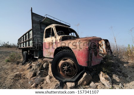Rusty Abandoned Truck on the Desert, in Canary Islands, Spain   - stock photo