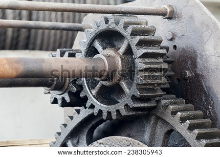 rusty and oily industrial gear and machinery - stock photo