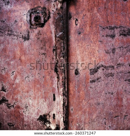 rusty and worn metal surface with cracks and corrosion with the old cracked paint on the length of time - stock photo