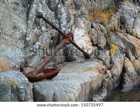 Rusty boat anchor - stock photo