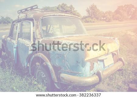 rusty broken accident car. - stock photo
