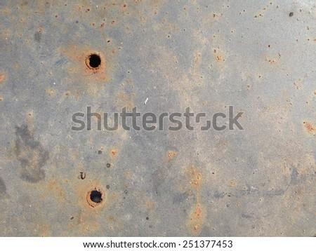 Rusty Bullet Holes - stock photo
