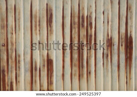 Rusty corrugated metal wall - stock photo