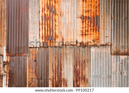 Rusty corrugated metal wall - stock photo
