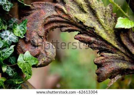 Rusty detail of a medieval grave decoration in Lacock village in England - stock photo