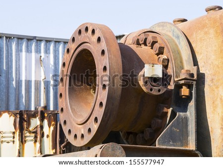 Rusty huge pipeline connection - stock photo