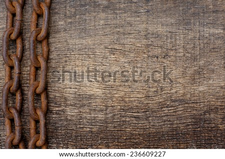 rusty iron chain on the side on a wooden texture background for themes - stock photo