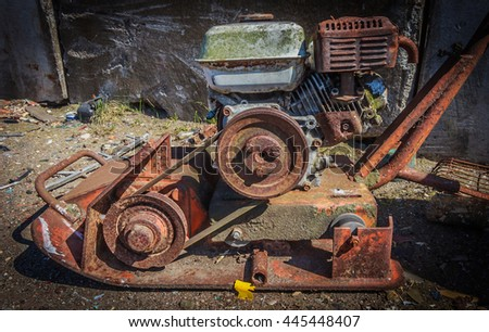 Rusty lawn mower,Rusty retro agricultural machinery - stock photo
