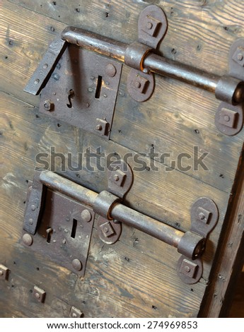 rusty lock with big deadbolt to close the door of the castle - stock photo