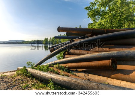 Rusty metal pipes in the forest closeup - stock photo