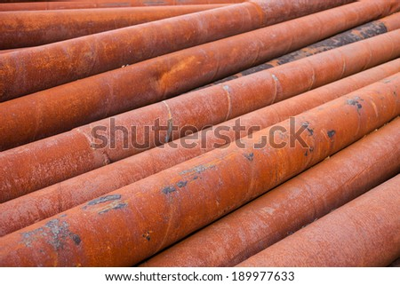 Rusty metal pipes stack. - stock photo