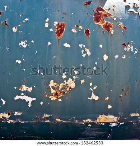 Rusty metal surface with an old peeling paint - stock photo