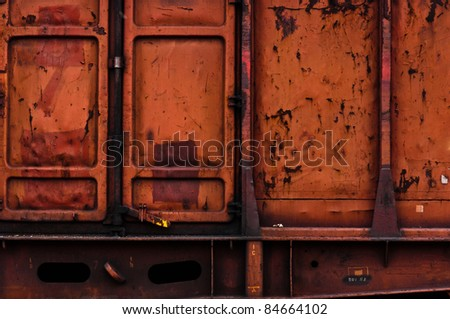 Rusty metal texture with doors - stock photo