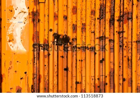 Rusty metal with bullet holes - stock photo