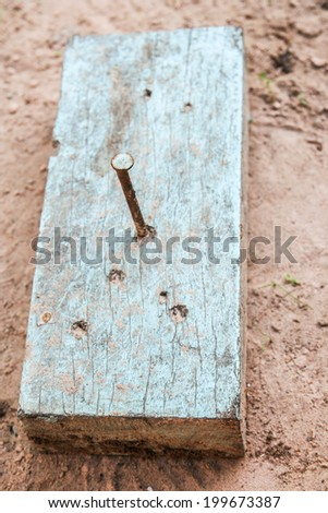 rusty nail in wood - stock photo